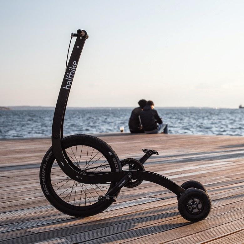 three wheeled Halfbike on city street