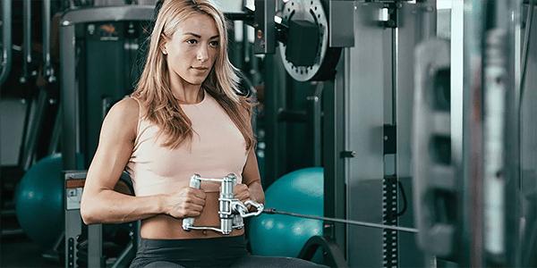 women exercising on fitness equipment